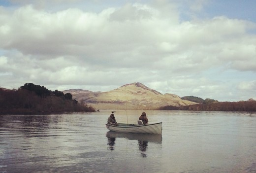 People in a boat fishing